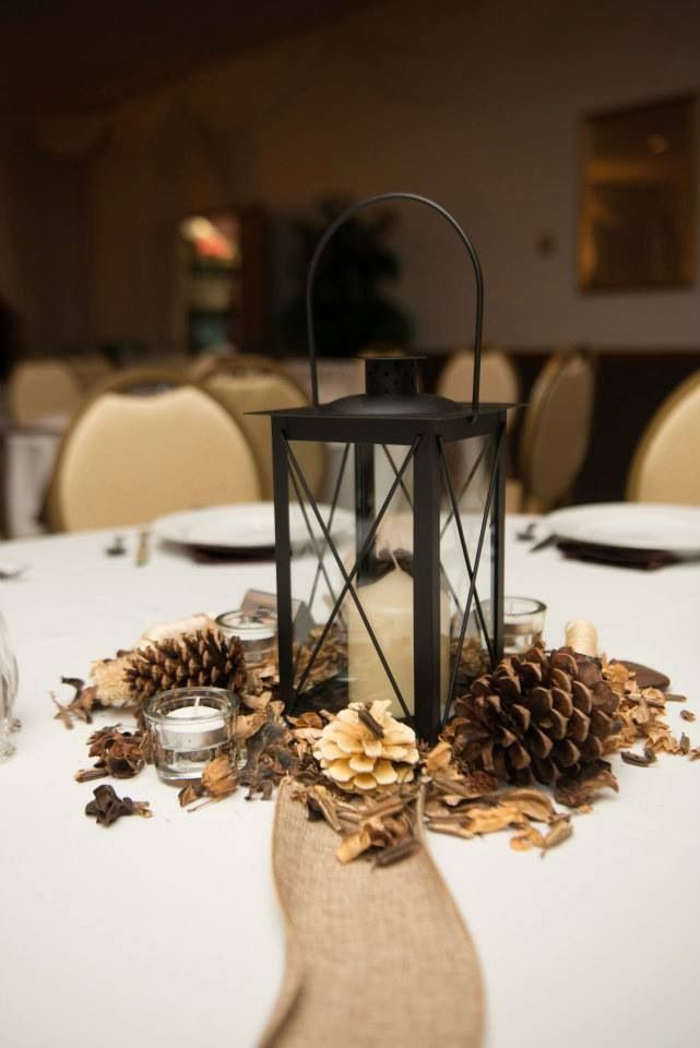 Lantern pinecone centerpieces                                                                                                                                                                                 More