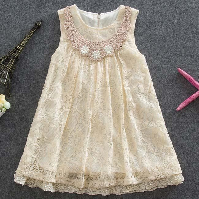 Beautiful ivory lace dress. Stunning collar detailed with sequin, looped beading, and pearls. Skirting trim is accented with pearls. Pearl pattern on collar may vary slightly from picture.
