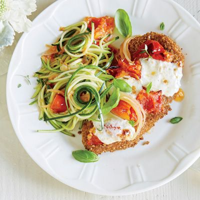 Learn how to make zoodles with this delicious recipe for chicken parmesan over zucchini noodles. You'll cut carbs and calories in half with this recipe from the Cooking Light Diet!