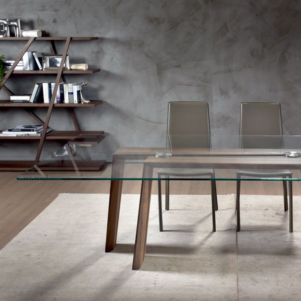 The exclusive Ten for Ten dining table is made in Italy by Pacini e Cappellini. The minimal and stylish wood base is made in solid walnut or ash, and the glass top is available in three sizes.