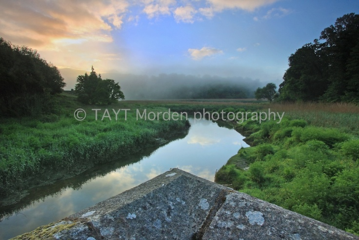 John S W Taylor  SUNRISE @ COTEHELE BRIDGE  Mounted Limited Edition   signed Photographic Print: 4/10  Image captured in the Tamar Valley,   Cornwall in May 2009.  Print: 33 cm wide x 22 cm high  Mount: 52 cm wide x 34 cm high  Neutral double mount   cellophane-wrapped  Authentic photograph printed on   silver-based light sensitive paper.  £55