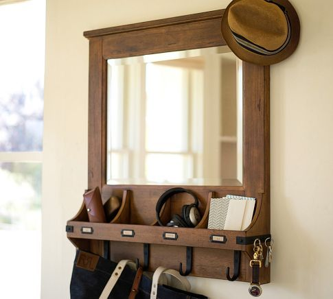 """Wall-Mount Organizer  Add storage while saving floor space in your entryway with our Chester design, made with plenty of drawers and hooks for bags, keys, hats and more.      33.25"""" wide x 6"""" deep x 36.75"""" high      Crafted of wood with a stained finish.      Features iron hardware with a bronze finish."""