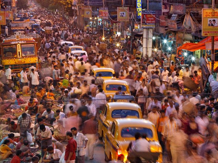 Street Scene, Kolkata Photograph by Randy Olson, Its steaming streets crammed with vendors, pedestrians, and iconic Ambassador taxis, Kolkata throbs with some 16 million people—and more pour in every day from small towns. In 1975 only three cities worldwide topped ten million. Today 21 such mega cities exist, most in developing countries, where urban areas absorb much of the globe's rising population.