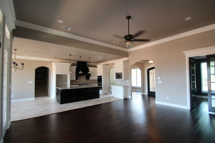 Couto Homes Paint Color Scheme  Sherwin Williams Perfect Greige on the walls Sherwin Williams Marshmallow on the trim and cabinets Sherwin Williams Tricorn Black on the island and vent hood and study doors