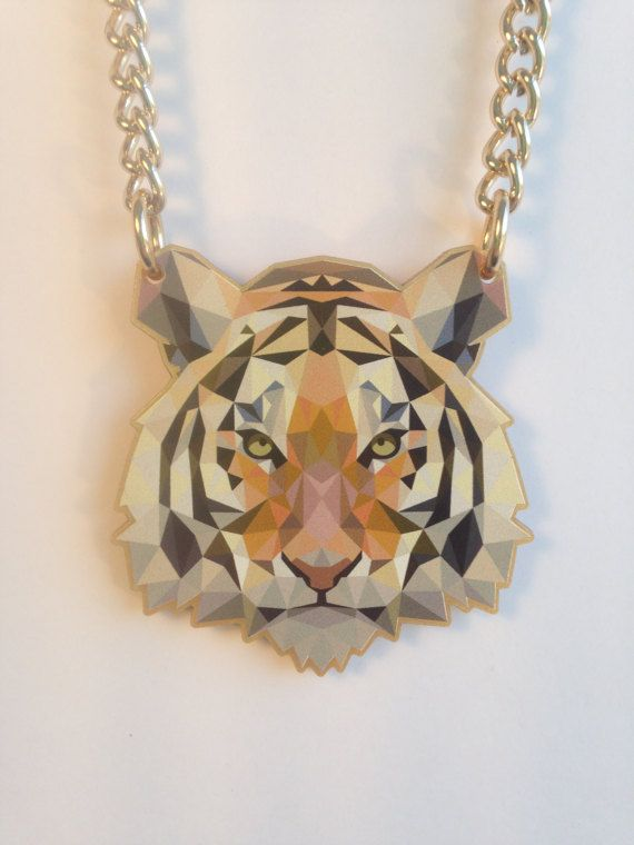 Make a STATEMENT with this bold, TIGER head necklace! Image UV printed onto gold acrylic; charm/ head size 6.2cm x 6.2cm Chunky, yet lightweight, light-gold coloured aluminium chain: link size approx 8.5mm x 6mm Chain length 44cm - 50cm including clasp Bright gold, gold-plated lobster clasp and bright gold aluminium jump rings. I have applied varnish but cannot guarantee full scratch resistance: store away from other items, ideally in original box.