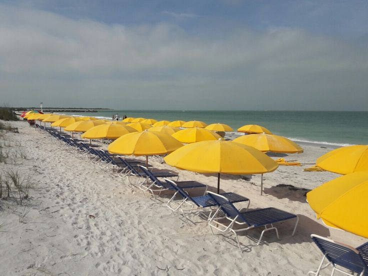 Commercial grade Beach umbrellas and powder coating aluminum chaise lounges for Taylor Beach Rental Pass a grille beach