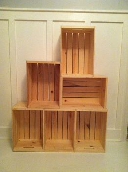 Create a bookshelf by stacking old wooden crates. Achieve different looks by places the crates on different angles. Don't forget to paint, stain, or treat the wood as well to create a finished look.