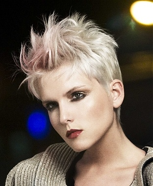 A short blonde straight spikey coloured hairstyle by Rae Palmer