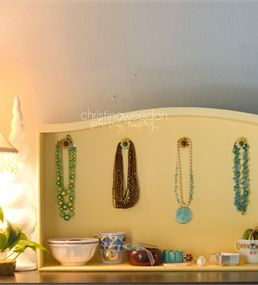 Christina turned an old dresser drawer into a stylish jewelry organizer.