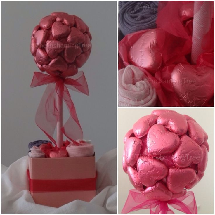 """Baby wear Tree.  Chocolates for the parents and baby wear for the new arrival.  Large (34 'Pink Lady"""" chocolate hearts) $70 Medium (22 """"Pink Lady"""" chocolate hearts) $55 Baby wear is Bonds and size 0-6 months."""