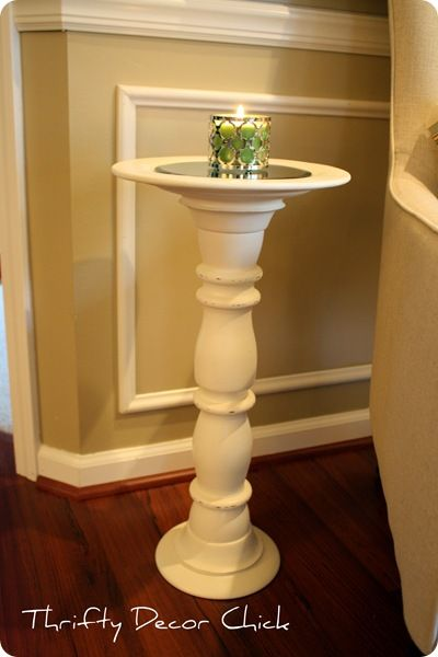 A table made from a Goodwill candlestick and an unfinished wooden plate.  Brilliant.
