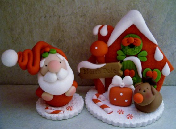 A 2 piece set that includes Santa and Rudolph at the North Pole!  This is an original design that was handcrafted from polymer clay. The house stands approximately 3 tall. All parts have been secured with liquid polymer for increased strength.    Not a toy...not suitable for young children.