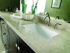 Want an easy, inexpensive color change for your bathroom? Paint that old, laminated countertop for a simple makeover with a big impact. Here's how to do it.