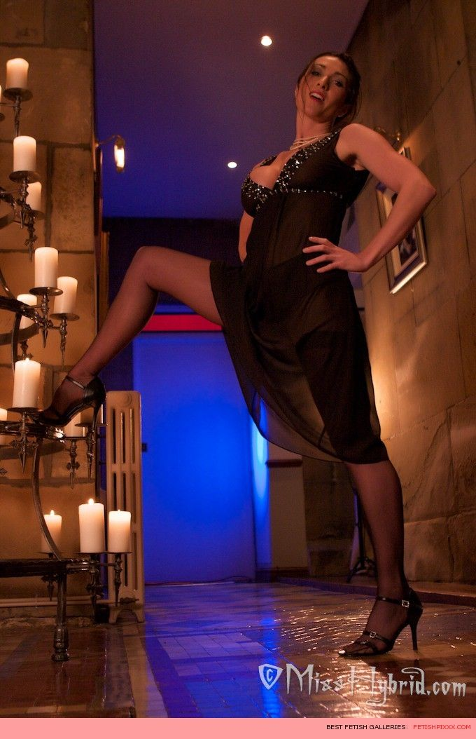 Candle wax sheer black dress and long legs in nylons