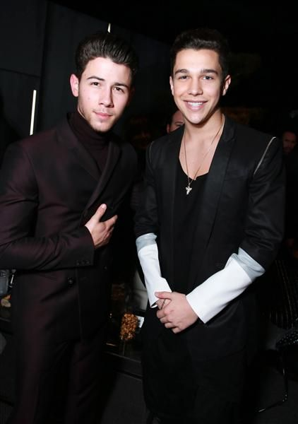 Nick Jonas and Austin Mahone attend Universal Music Group's 2015 Grammy afterparty presented by American Airlines and Citi at The Ace Hotel in Los Angeles on Feb. 8, 2015.