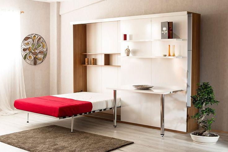 DUBLE SALON  Özellikle Stüdyo daire dekorasyonu için ideal bir modül ! Gizlenmiş çift kişilik dikey açılır yatak, TV ünitesi, vitrin/ kitaplık ve ekstra dolap özellikleri ile alan tasarrufu sağlayan, yenilik ve yaratıcılığı bir arada sunan duvar ünitesi. Yatağı, sürgü-ray üzerinde sağa ve sola hareket eden vitrin kapağı arkasında gizlidir. Ünite, yatak kapalı konumda iken sadece dekoratif bir TV ünitesi görünümündedir. İç yatak ölçüsü : 140 cm x 190 cm x 18 cm