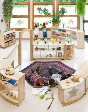 The set up of this room is what I am interested in. This layout allows for the children to see all the centers available, and pick which center they want to play and learn in. Each center also seems to be 'themed' toward a specific idea of learning.