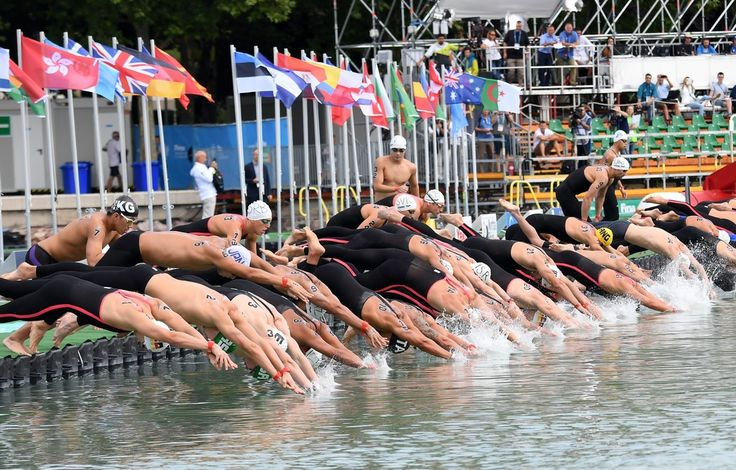 Athletes compete at the start line during the men's 5km open water swimming event at the 2017 FINA World Championships in Balatonfured on July 15, 2017.   / AFP PHOTO / ATTILA KISBENEDEK