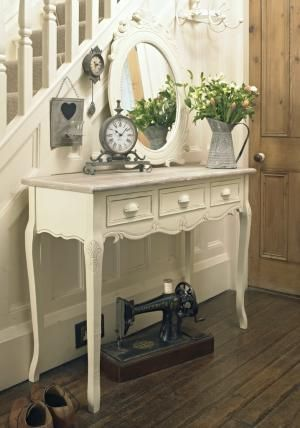 Cream & Natural wooden 3 drawer console table  Incredibly stylish - a traditional french style look with some ornate detailing  With a limed finish solid wood Top with a distressed cream finish  with 3 drawers and Curved legs & curved features evoke the traditional look  can be used as a dressing table or console table  Several matching items in this range