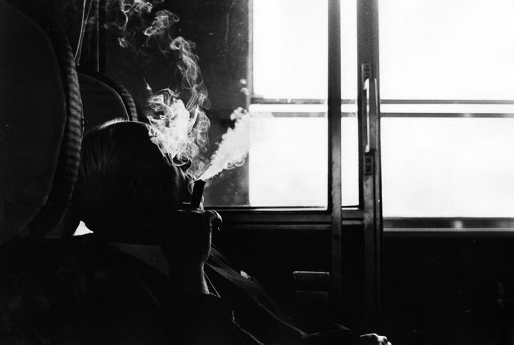 MAN WITH CIGAR ON TRAIN - NEAL SLAVIN PHOTOGRAPHY