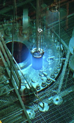 Blue glow of Cherenkov radiation at ORNL's High Flux Isotope Reactor where berkelium is made to create element 117 © Oak Ridge National Labo...