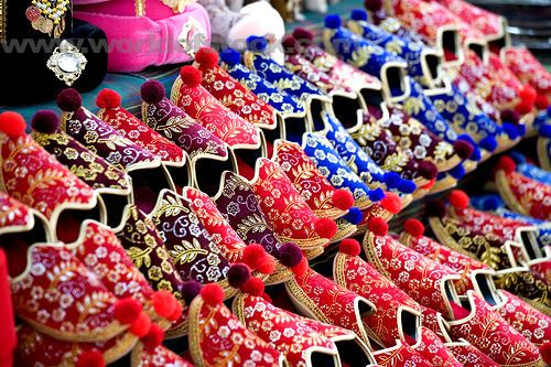 Be spellbound by a street vendor display of colourful tasseled Turkish slippers at Sultanahmet, Istanbul, Turkey