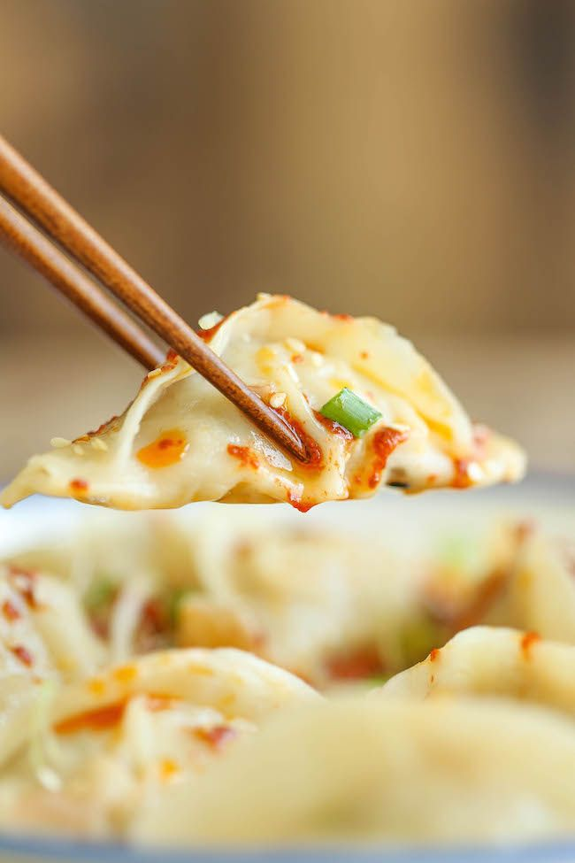 Spicy Chicken Potstickers - Make-ahead, freezer-friendly dumplings made completely from scratch with an optional hot chili oil sauce for a kick of heat! @ Damn Delicious. net