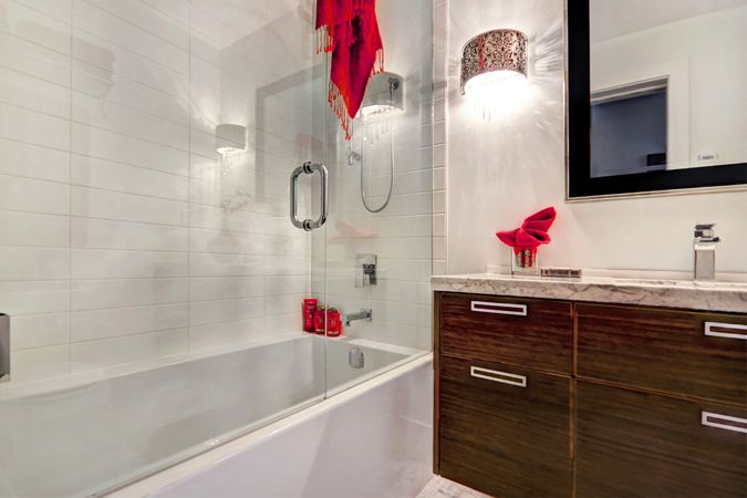 8mm glass shower door, and custom floating wenge cabinetry