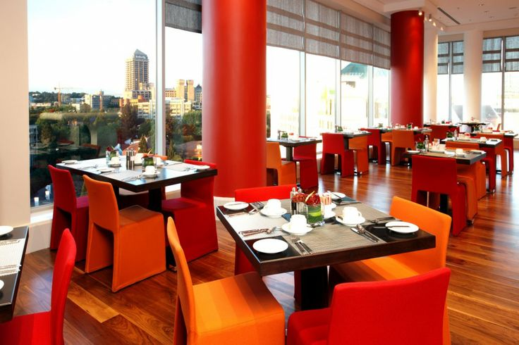 Radisson Blu Sandton Hotel, Johannesburg - mkv desgin. Red and Orange dining chairs