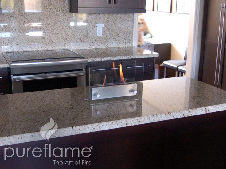 glass fire tabletop fireplace is a perfect solution for those who want a fireplace but