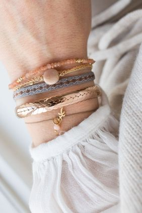 Our summer impression shown in a combiNATION of bracelets in soft colors, shiny…
