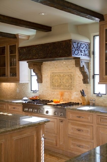 A decorative hood. The stove or range hood is very often a kitchen's focal point. Create interest with details such as this carved trim piece. Timber and Mexican tiles are other materials that can showcase this area.