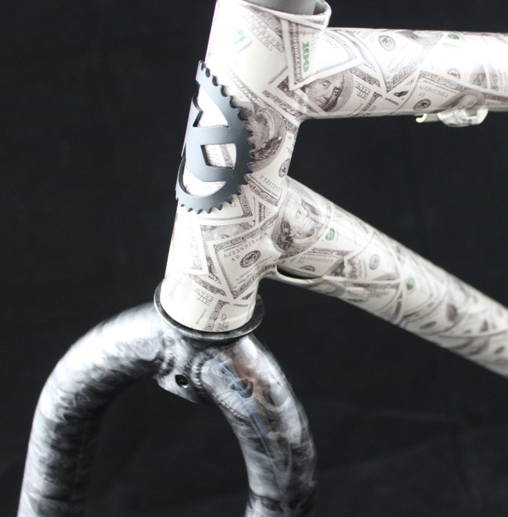 Kona Unit frame dipped in a hydro graphic skin of 100 dollar bills, the fork was coated in  skulls. Making it the Death and Taxes bike. you can have this for $800 dollars or less on your frame.
