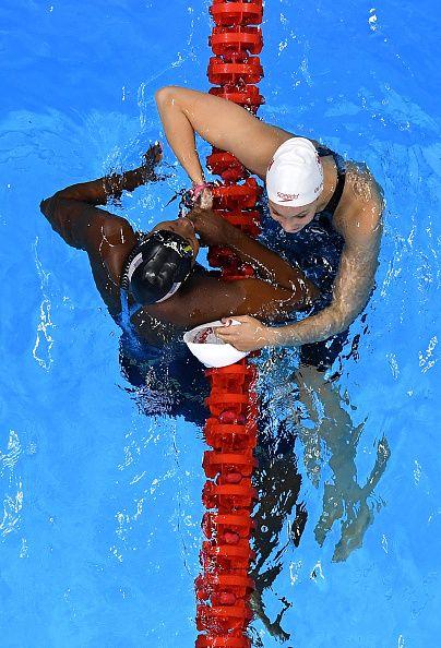 #RIO2016 Simone Manuel of the United States embraces Penny Oleksiak of Canada…