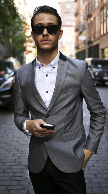 Shop this look for $140:  http://lookastic.com/men/looks/white-longsleeve-shirt-and-grey-blazer-and-black-dress-pants/778  — White Longsleeve Shirt  — Grey Blazer  — Black Dress Pants