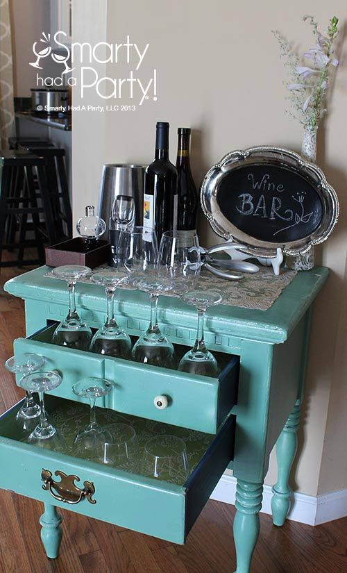 DIY a mini wine bar using an small nighstand.