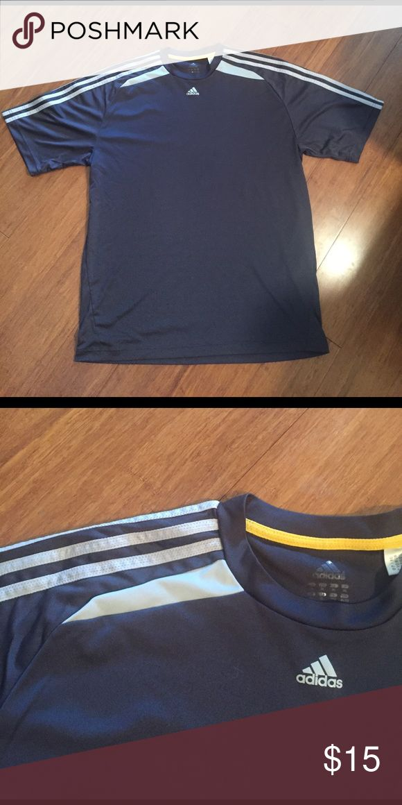 Adidas dark gray athletic shirt Great condition, worn a few times. Dark gray with light gray stripes on shoulders. 100% polyester Adidas Shirts