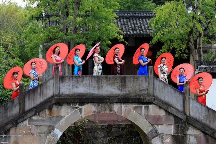 A Cheongsam show in ancient residences of Huangshan City, Anhui Province. [Credit: photostock.china.com.cn]