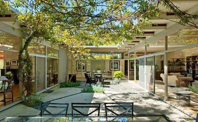 A house where all of it, or at least some of it, wraps around an amazing outdoor space would be amazing.