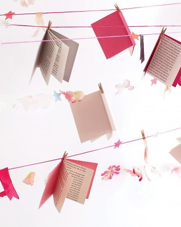 Baby Book Garland :: Have your guests bring a book for the new baby. Use a clothespin to hang each book on a clothes line (or similar) for an enchanting story book garland.