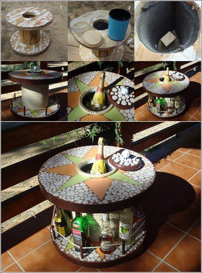 Industrial wire spool repurposed into a win liquor storage / serve table