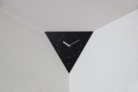 Clock for the corner of the ceiling - smackdesign nook-hole