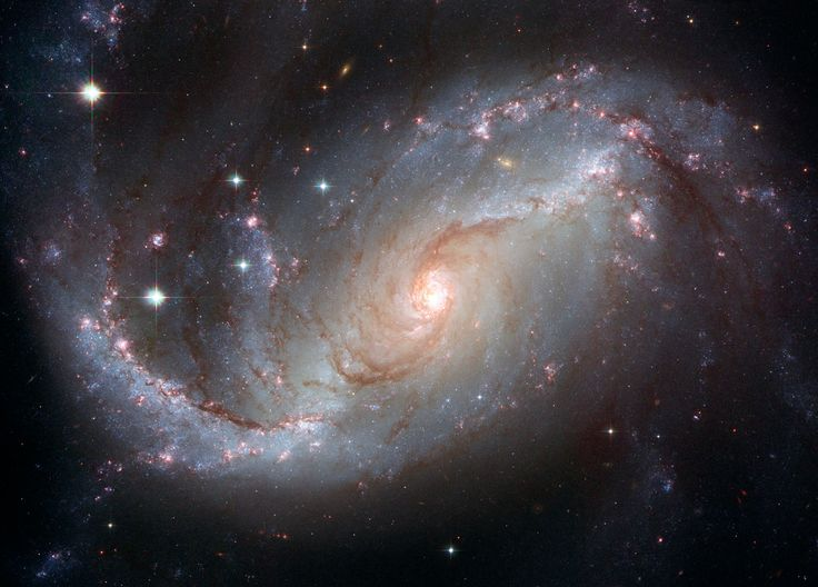 NGC 1672 : Barred Spiral Galaxy - There are 3 types of galaxy nuclei : HII region, similar in spectrum to star formation in the Milky Way associated with nuclear star formation, Seyfert nucleus, a type of active galactic nucleus (AGN) or low ionization nuclear emission-line region having spectral emission from weakly ionized gas that could contain either a star formation region or supermassive black hole. NGC 1672's spectrum falls between the classifications - Credit : NASA/ESA
