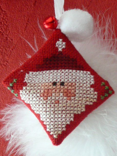 Santa Fob • small santa or part of a bigger design makes as delightful fob. It would look lovely adorning a Christmas gift.