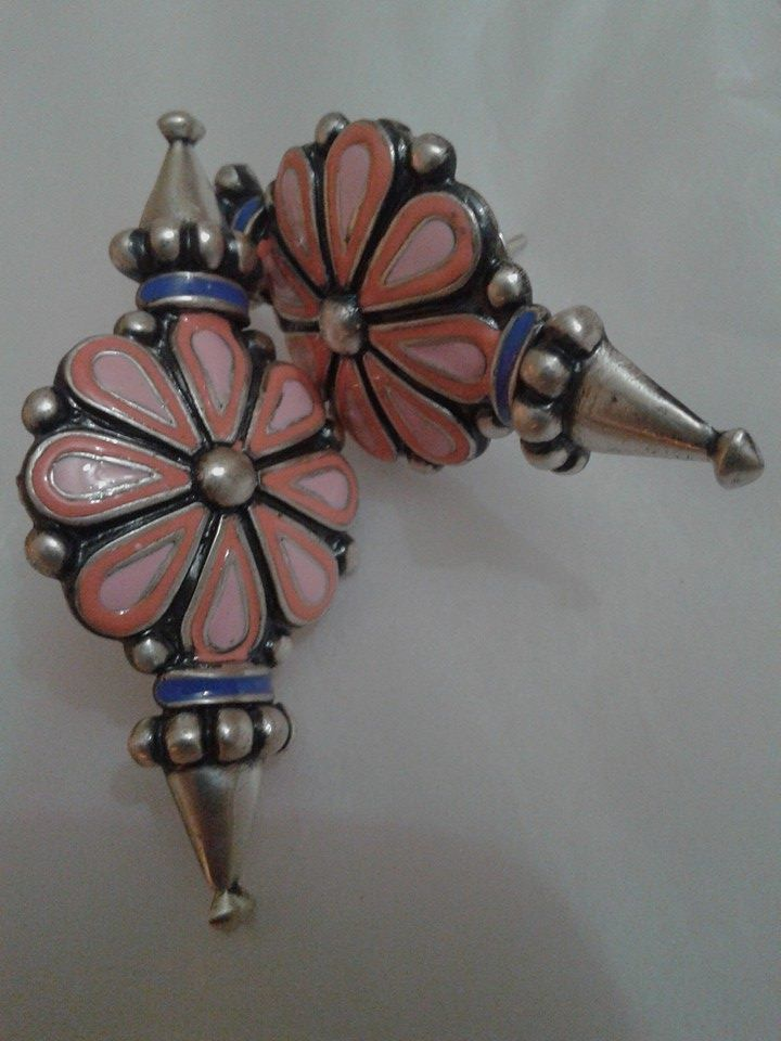 Amrapali studs with spikes from chnadrika collection.. its colours add wow effect to this silver flower studs