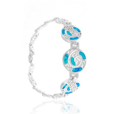 An exquisite 925 fine silver bracelet featuring Circle of Life links in fine silver. The bracelet is joined together by three larger Circle of Life links with blue opal inlay. Symbol of the eternity of all things in the universe and the cyclical nature of life in ancient Greece, the polished silver finish of the bracelet makes a breathtaking contrast with the vibrant blue colour of the opal stone. Wear it daily and carry with you a piece of the Greek blue summer sky.