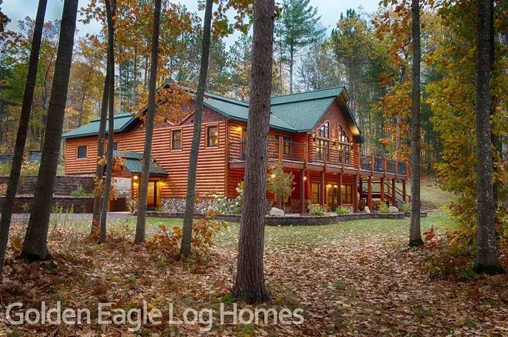 Our North Carolina floor plan surrounded by fall foliage. Photos and floor plans of this custom home are at www.GoldenEagleLogHomes.com  #loghomes #loghome #logcabins #cabin #logcabins #home #homes #houzz #rusticliving #outdoors #nature #loghomeliving #construction