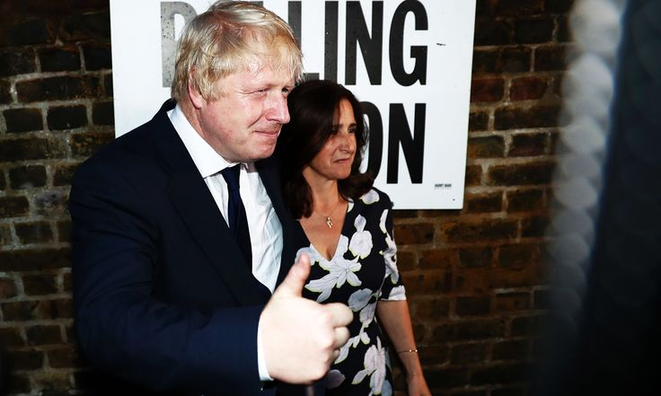 Former London Mayor and Vote Leave campaigner Boris Johnson (L) and his wife Marina Wheeler pose for the media outside a polling station in north London on June 23, 2016, as he casts his vote in a national referendum on whether to remain in, or to leave the European Union (EU). Millions of Britons began voting Thursday in a bitterly-fought, knife-edge referendum that could tear up the island nation's EU membership and spark the greatest emergency of the bloc's 60-year history. / AFP PHOTO…