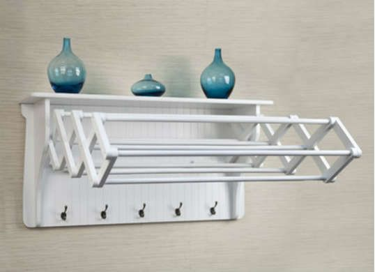 This drying rack is a great solution for a small laundry room. It expands for when you need it, and collapses to an attractive shelf when you don't.