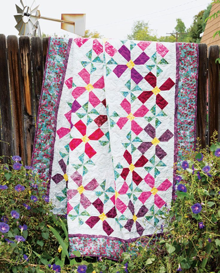 Simple pieced quilt blocks come together to grow a gorgeous flower garden on this queen-sized quilt pattern.